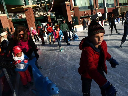 Seven-year-old Jacob Koval, right, makes his way around