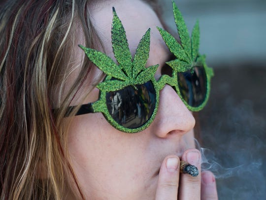Rachel Brown of Grand Haven smokes during Hash Bash