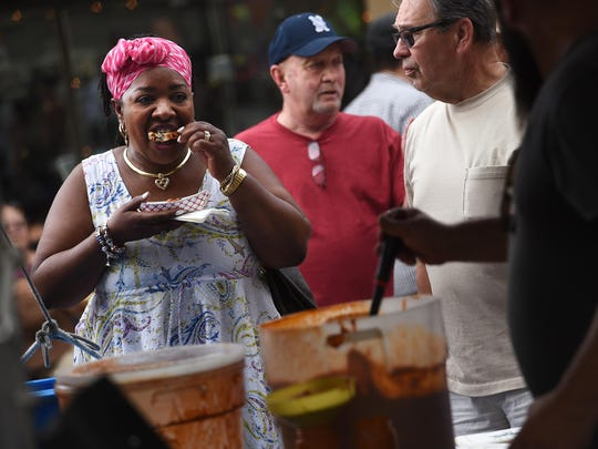 Patrons eat wings during the Biggest Little City Wing Fest in downtown Reno on July 2, 2015.