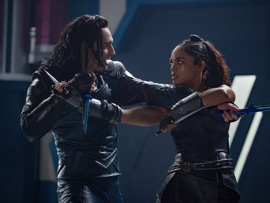 "Loki (Tom Hiddleston) faces off with Valkyrie (Tessa Thompson) in ""Thor: Ragnarok."""