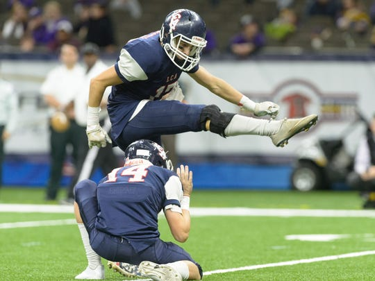 Knights kicker Colin LaHaye kicks a field goal as Lafayette Christian Academy takes on Ascension Catholic Bulldogs in the state championship game in New Orleans Thursday, Dec. 7, 2017.