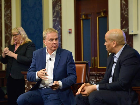 NPR's Tom Ashbrook with U.S. Sen. Cory Booker of New Jersey at the Edward M. Kennedy Institute for the United States Senate on February 28, 2016 in Boston.