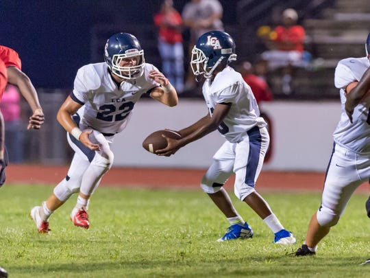 Knights quarterback Cowinn Helaire hands off to runningback Dalen Gondron as the Northside Vikings host LCA. Friday, Aug. 31, 2018.