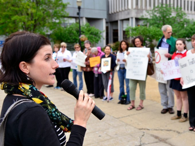 Amy Nace-Degonda, Louisville Human Trafficking Task Force, speaks to supporters. Members and associates of the Sisters of Charity of Nazareth held a public prayer service for victims of human trafficking at Jefferson Square Park on Tuesday. April 29, 2014