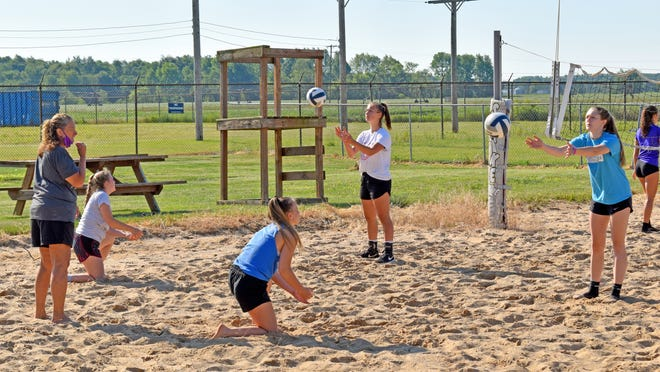 The Bronson Lady Vikings volleyball program began their summer conditioning program, led by head coach Jean LaClair (left with mask) in the sand volleyball pits outside of Bronson Strike Zone Tuesday.    [DON REID PHOTO}