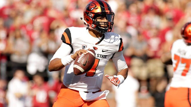 Oregon State quarterback Seth Collins (4) looks for a receiver during the first half of an NCAA college football game against Washington State, Saturday, Oct. 17, 2015, in Pullman, Wash.