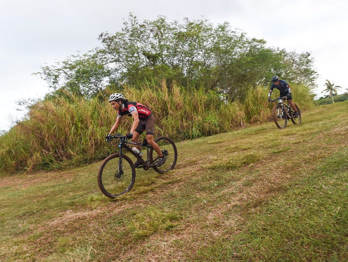 Mountain bikers compete during the Guam Cycling Federation