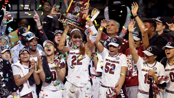 South Carolina forward A'ja Wilson (22) holds the trophy as she and teammates celebrate their win over Mississippi State in the final of NCAA women's Final Four college basketball tournament, Sunday, April 2, 2017, in Dallas. (AP Photo/Eric Gay)