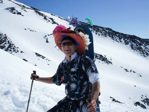 Each Mother's Day, when the weather is clear, hundreds of people head up the Cascade Range's Mount St. Helens wearing every style of costume, from the most popular item, dresses (to honor mom) to more whacky outfits, like Darth Vader.