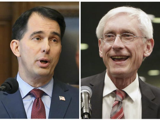 This combination of file photos shows Wisconsin Republican Gov. Scott Walker, left, and his Democratic challenger Tony Evers in the 2018 November general election.
