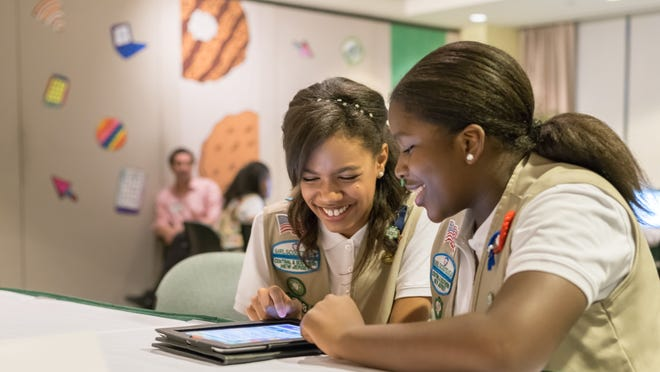 Girl Scouts Bria Vainqueur (left) and Shirell Battle (right) with Girls Scouts of Central and Southern New Jersey practice selling cookies on one of two new digital platforms. It's the first time Girls Scouts of the USA has allowed sale of cookies using a mobile app and personalized websites. The Digital Cookie program is intended to enhance, not replace, traditional paper spreadsheets.