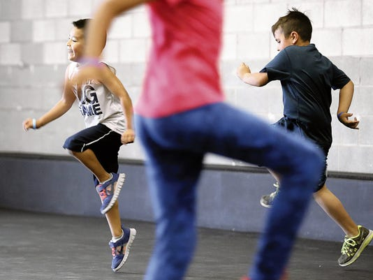 MARK LAMBIE—EL PASO TIMES  Holly Cohen Mata's Kids Crossfit class combines exercise with fun to keep kids' attention.