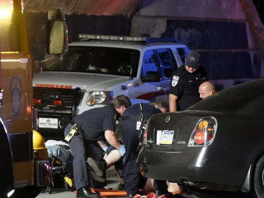 Police and emergency crews remove a shooting victim while responding to a shooting at the intersection of Fourth Street and King Street in Chambersburg on Tuesday, May 12, 2015. Ryan Blackwell - Public Opinion