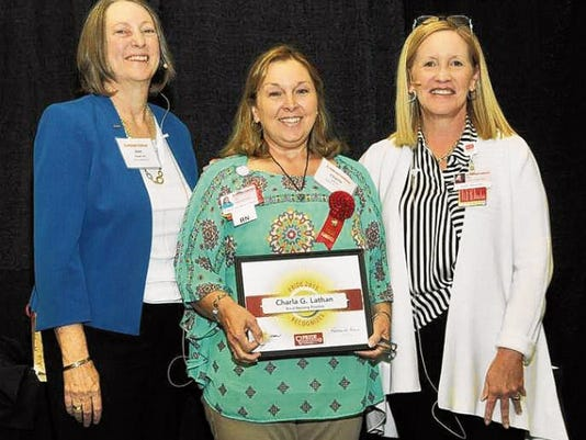 Lincoln County Medical Center's Charla Lathan received a P.R.I.D.E award as an outstanding nurse who has made a significant contribution to Presbyterian and the nursing profession. From left: Presbyterian Healthcare Services Chief Nursing Officer Ann Wright, LCMC's PRIDE winner nurse Charla Lathan and Senior Vice-President Kathy Davis.