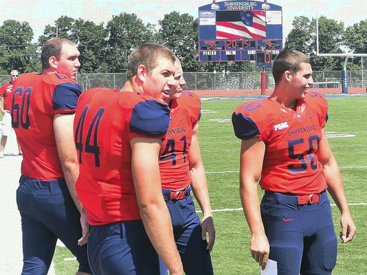 The Shippensburg University football team steps onto the field in new uniforms for Media Day on Saturday. The Red Raiders were voted to finish third in the PSAC East this season.