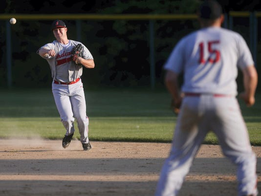 Manchester's Dan Royer throws to first for the out during a Central League baseball game in Dover on July 16. Dover beat Manchester, 9-2.