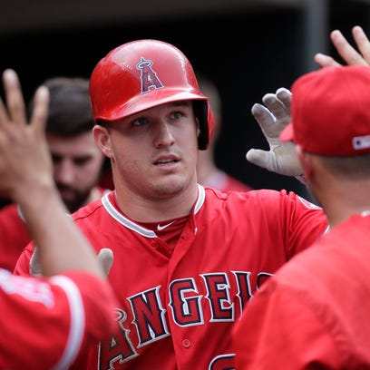 Los Angeles Angels' Mike Trout is congratulated after