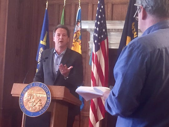 Gov. Steve Bullock, left, answers questions Friday