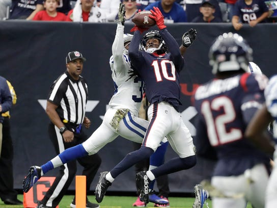 Houston Texans wide receiver DeAndre Hopkins (10) pulls in a 34-yard catch for a touchdown in front of Indianapolis Colts cornerback Pierre Desir (35) during the second half of an NFL football game Sunday, Nov. 5, 2017, in Houston. (AP Photo/David J. Phillip)