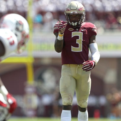 FSU's Derwin James points out the NC State offense