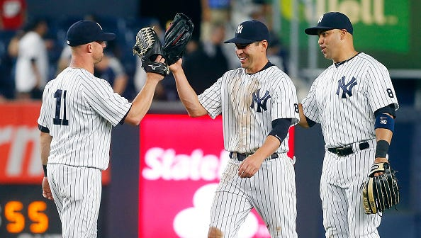 NEW YORK, NY - APRIL 22:  Brett Gardner #11, Jacoby Ellsbury #22 and Carlos Beltran #36 of the New York Yankees celebrate after defeating the Tampa Bay Rays at Yankee Stadium on April 22, 2016 in the Bronx borough of New York City.