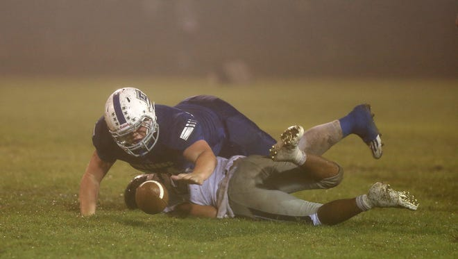 Eden's Cole Bible scrambles for a loose ball after tackling Water Valley's Manny Gamboa on Sept. 29, 2017 in Eden.