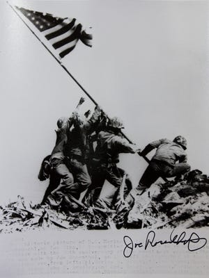 A family copy of the famous Feb. 23, 1945, photo by Joe Rosenthal of Ira H. Hayes and other servicemen raising the U.S. Flag atop Mount Suribachi during the battle of Iwo Jima in World War II.