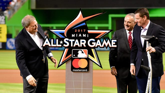 Marlins owner Jeffery Loria,  MLB commissioner Robert Manfred and former Marlins player Jeff Conine unveil the logo for the 2017 game.