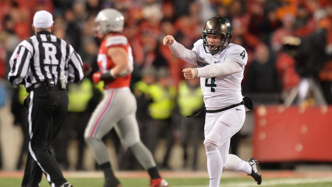 Michael Geiger runs down the field after kicking the winning field goal for Michigan State.