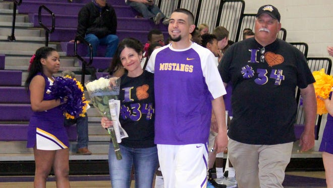 WNMU's Adam Kesler walks out with his parents during Senior Night on Friday. He tallied six points in his final game as a Mustang.