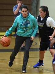 Reed coach Sara Schopper-Ramirez dribbles as she plays with her team during practice at the Reed gym on Jan. 2, 2017.
