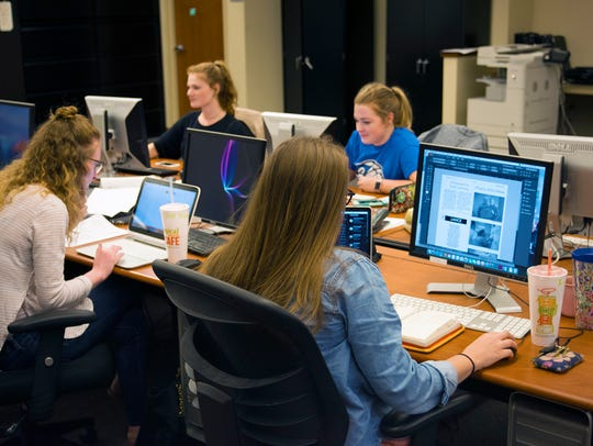 Journalism students at Evangel University working on