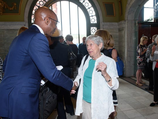 During a recent luncheon, Ohio's Regional President for The Enquirer/USA Today Network Eddie Tyner talks with a past Women of the Year honoree.