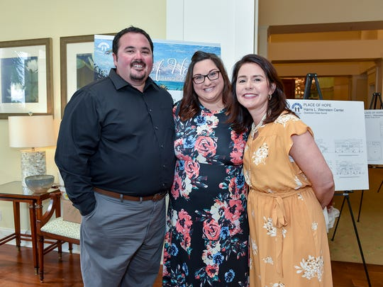 Place of Hope's Foster Family of the Year recipients Richard and Ericah Brinson, left, and event co-chair Deana Peterson.
