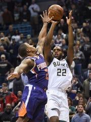 Jan 22, 2018: Milwaukee Bucks forward Khris Middleton (22) takes a shot against Phoenix Suns guard Isaiah Canaan (2) in the fourth quarter at BMO Harris Bradley Center.