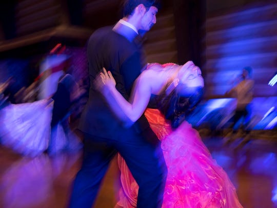 """Baileigh Montgomery is dipped by Jeremy Morgan during the """"Senior Waltz"""" at the Reitz High School Prom at Burdette Park's Discovery Lodge Saturday evening."""