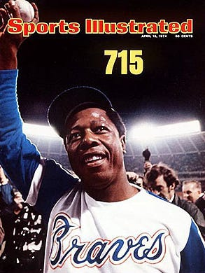 Hank Aaron breaks Babe Ruth's home-run record by smacking his 715th homer.