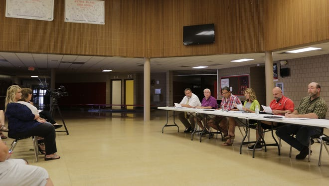Attica Consolidated School Corp. Treasurer Carrie Brier, far left, sat in the front row of a public meeting held by the school board Wednesday night. Brier was the center of a controversial audit of the district's finances.