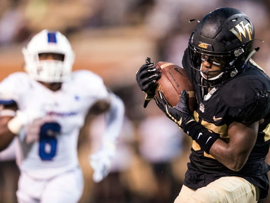 Wake Forest redshirt freshman wide receiver Greg Dortch, right, makes a touchdown reception against Presbyterian during an NCAA coollege football game Thursday, Aug. 31, 2017, in Winston-Salem, N.C. (Andrew Dye/The Winston-Salem Journal via AP)