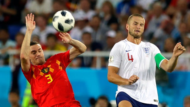 Belgium's Thomas Vermaelen vies for the ball with England's Eric Dier.