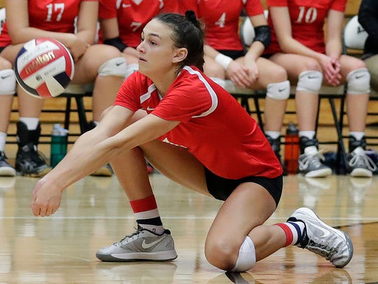 Kimberly's Kalli Mau digs a ball against Bay Port in a WIAA Division 1 girls volleyball sectional semifinal at Ashwaubenon High School.