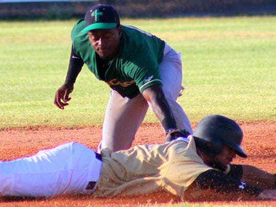 Tucson Saguaros shortstop Davon Poole tags White Sands' Dubal Baez during a pick off attempt Wednesday evening at the Griggs Sports Complex.