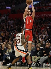 Portland Trail Blazers' Mario Hezonja (44) shoots over Los Angeles Clippers' Lou Williams (23) during the first half of an NBA basketball game Thursday, Nov. 7, 2019, in Los Angeles. (AP Photo/Marcio Jose Sanchez)