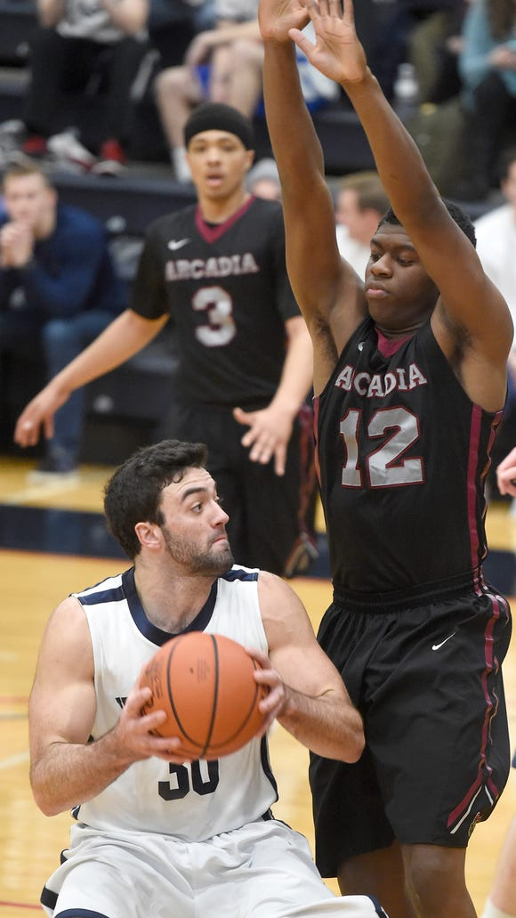 Lebanon Valley's Will Boccanfuso pulls down a rebound guarded by Arcadia University's Keith Bacote during Saturday's contest at LVC.
