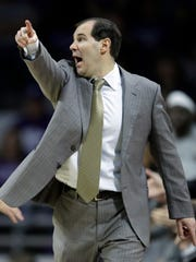 Baylor head coach Scott Drew directs his team during the first half of an NCAA college basketball game against Kansas State in Manhattan, Kan., Saturday, March 3, 2018. (AP Photo/Orlin Wagner)