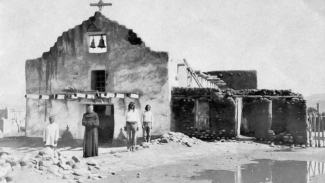 Father Stanley is pictured at the San Diego Church in James, New Mexico.
