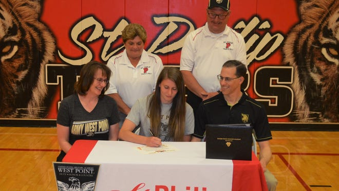 St. Philip senior Sarah Guzzo signs to compete in track at West Point. She is joined by her parents Ed and Helen Guzzo and her Tiger track coaches.
