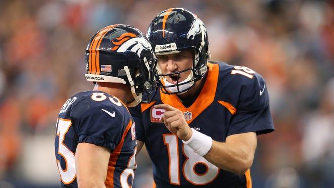 Broncos quarterback Peyton Manning (18) should have wide receiver Wes Welker, left, for Denver's first playoff game on Jan. 11 or 12, if not for Sunday's regular-season finale at Oakland.