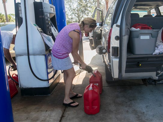 Angie Post gets gas for her truck and generator on