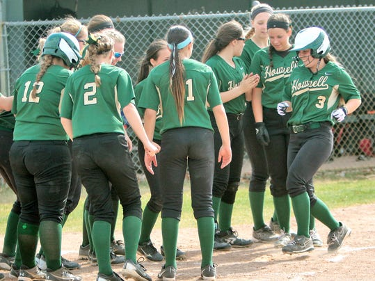 Mackenzie Gilmer is greeted at home by her team after her homerun[1].jpg